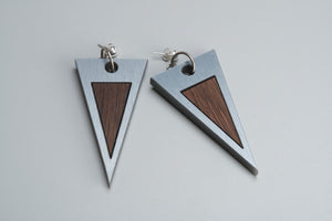 Elegant geometric earrings made of metallic acrylics and wood.
