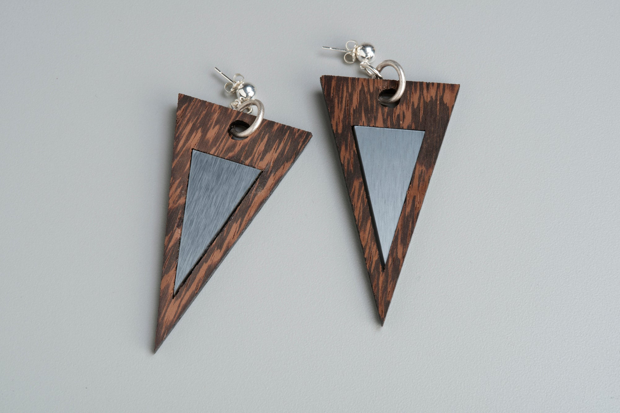 Triangle modern wood earrings with sterling silver post. Adds a great coolness to your casual outfit.