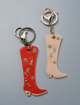 Cowboy boot key chain in red or light pink acrylic. Handpainted. Makes a perfect gift.