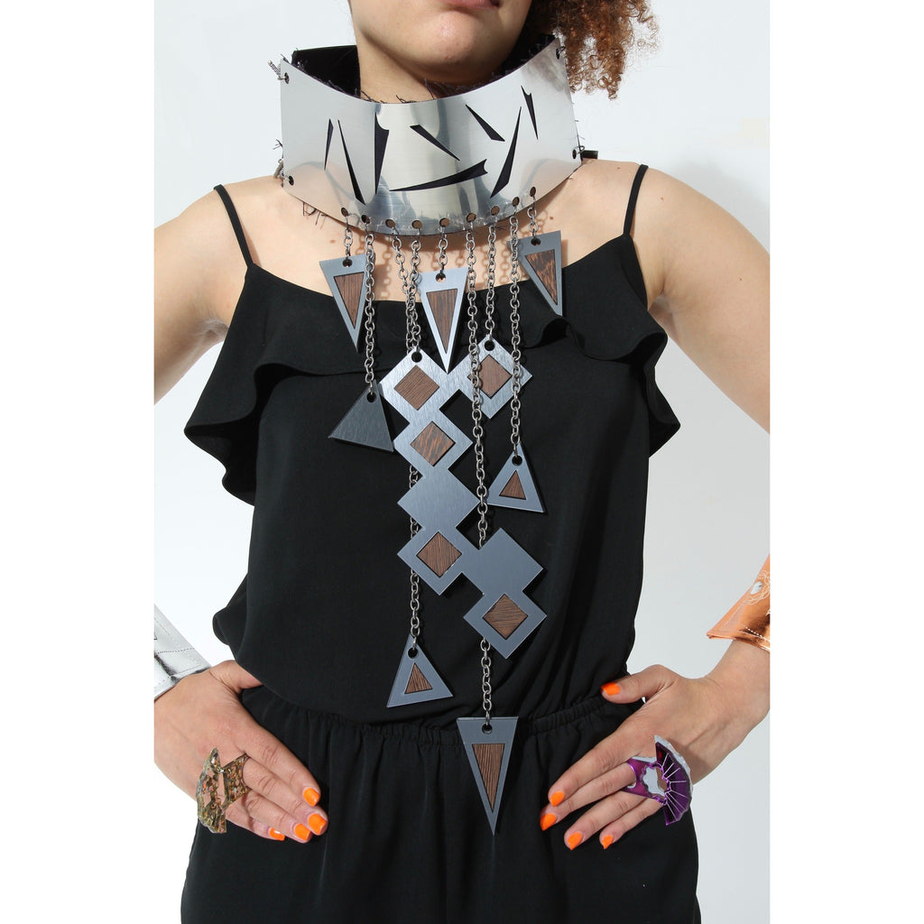 Bold futuristic metallic and denim choker. Contains some wood and silver components. Great for special occasion, one-of-a-kind events and festivals.