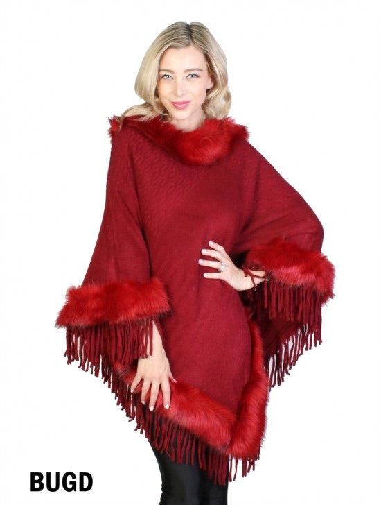 Red poncho with red faux fur trim/tassels