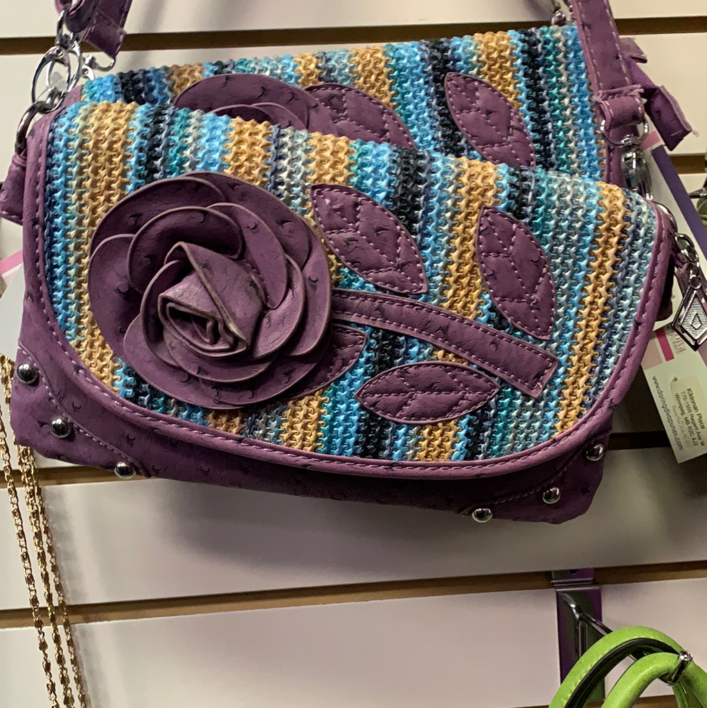 Purple clutch messenger with flower front
