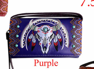 Purple skull wallet with feathers