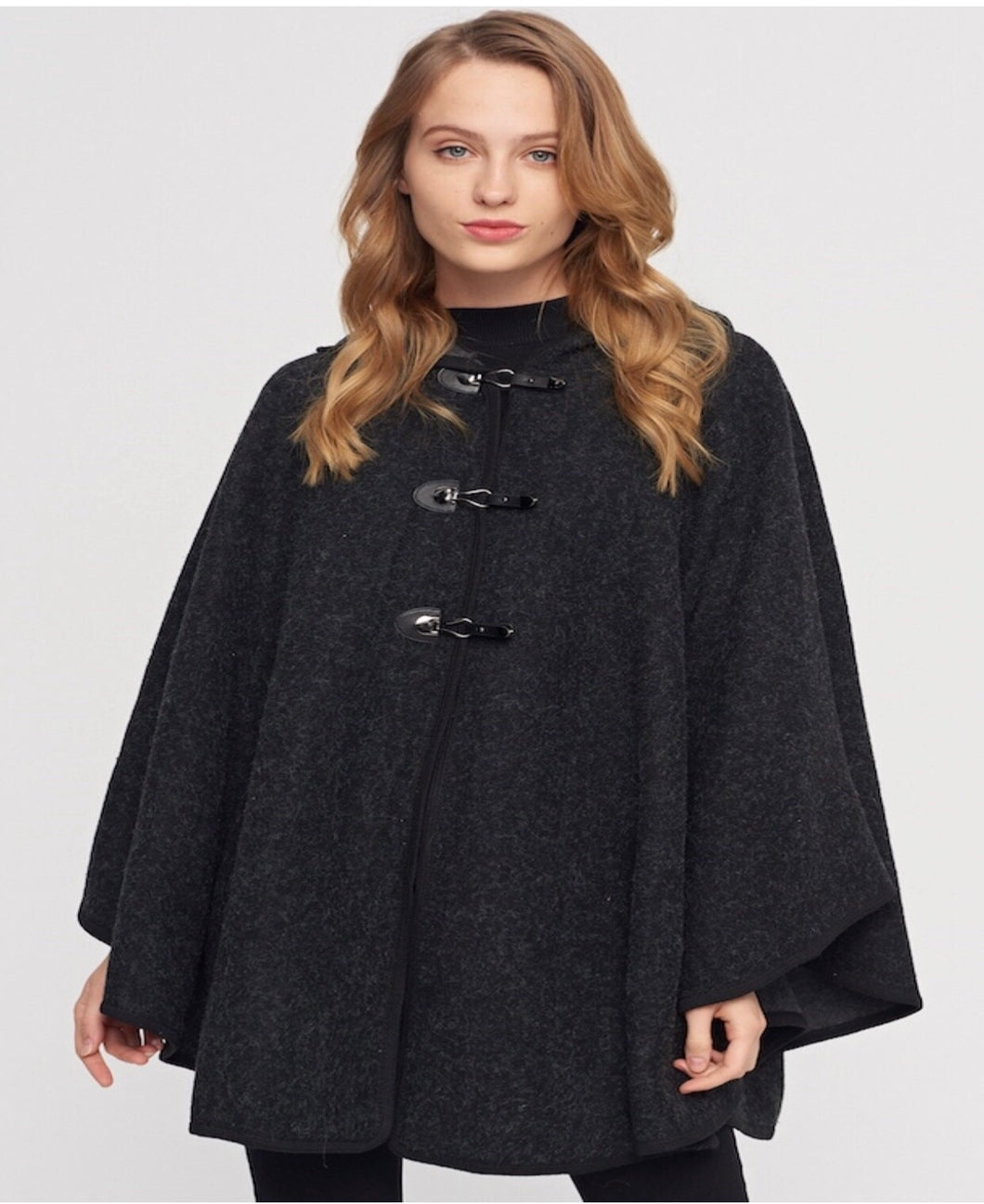 Black hooded poncho with 3 snap closure