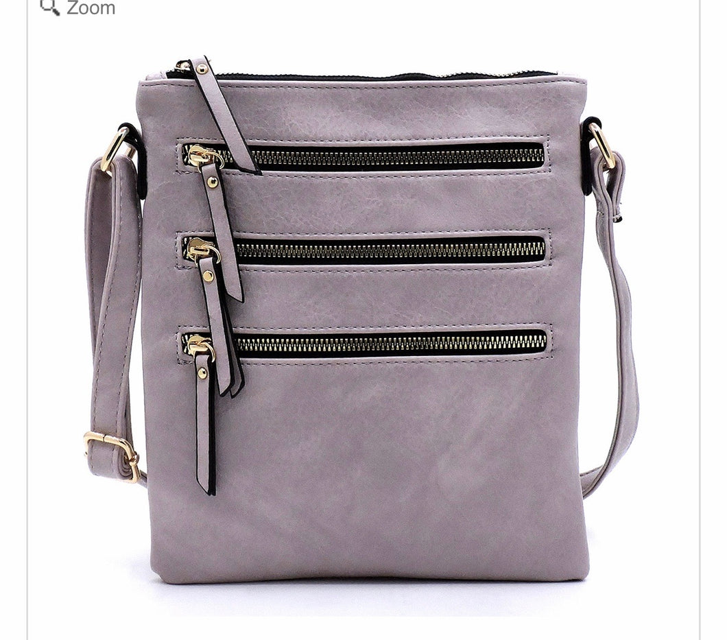Lavender messenger with 3 zippers