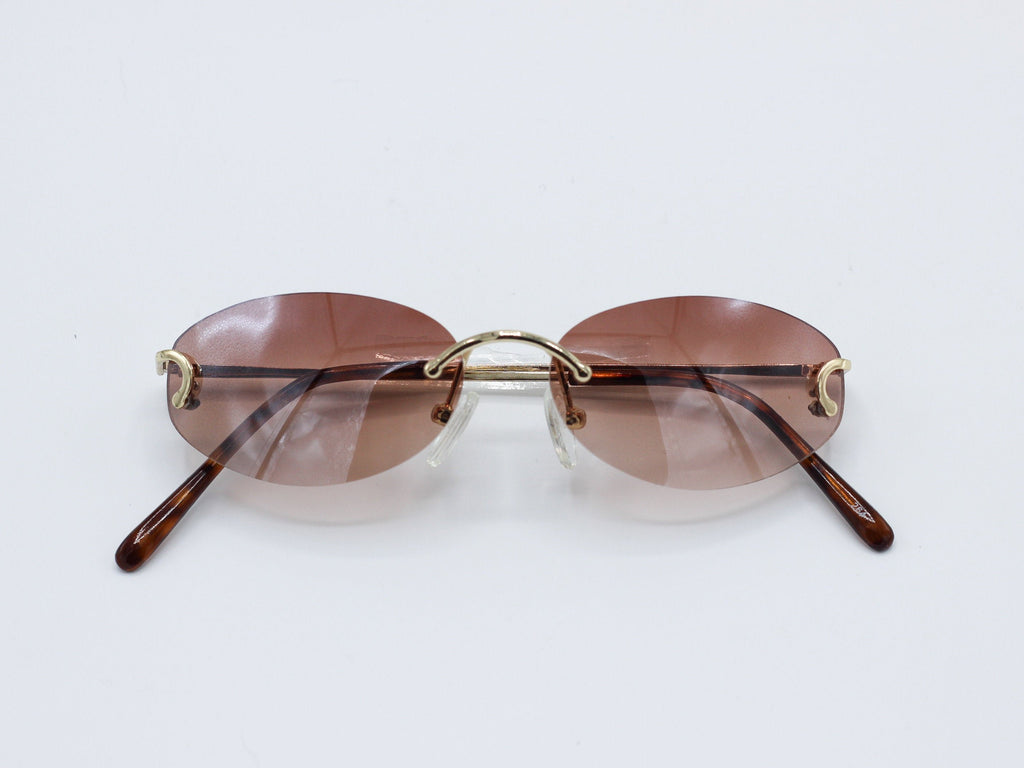 1990's Vintage Rimless Rapper Tinted Lens Oval Sunglasses
