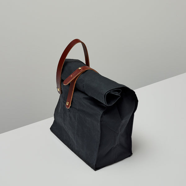 Product image of Roll top bag ~ black and tan
