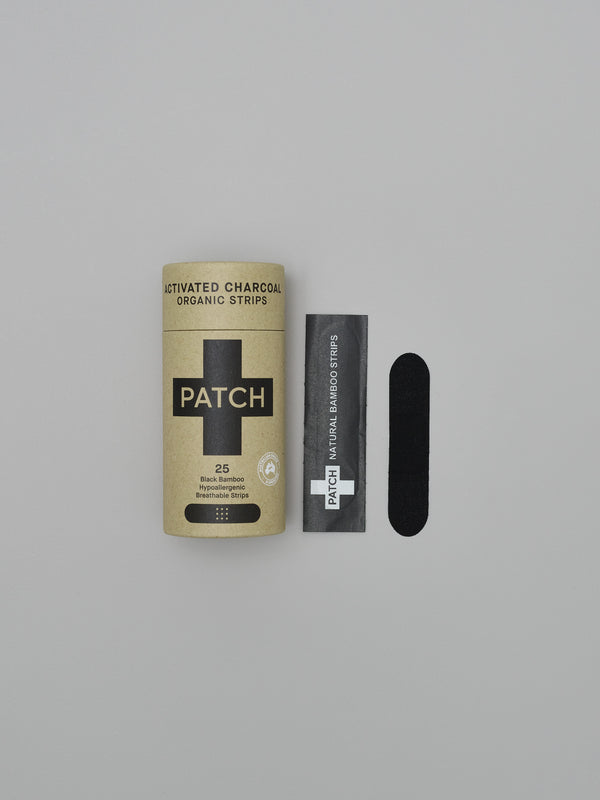 a pack of patch natural organic charcoal plasters in a cardboard tube