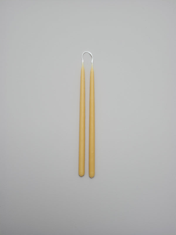 Thin tapered beeswax candle