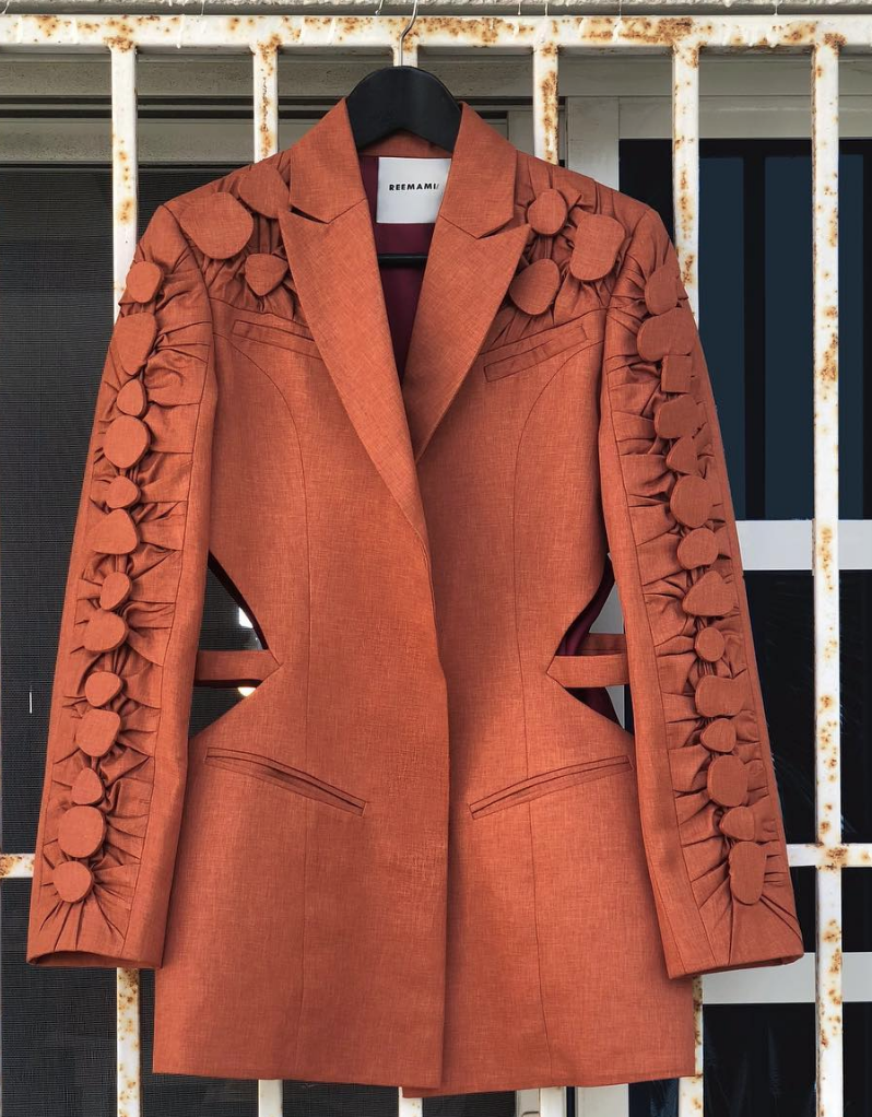 beautiful orange blazer with beaded details and cutouts