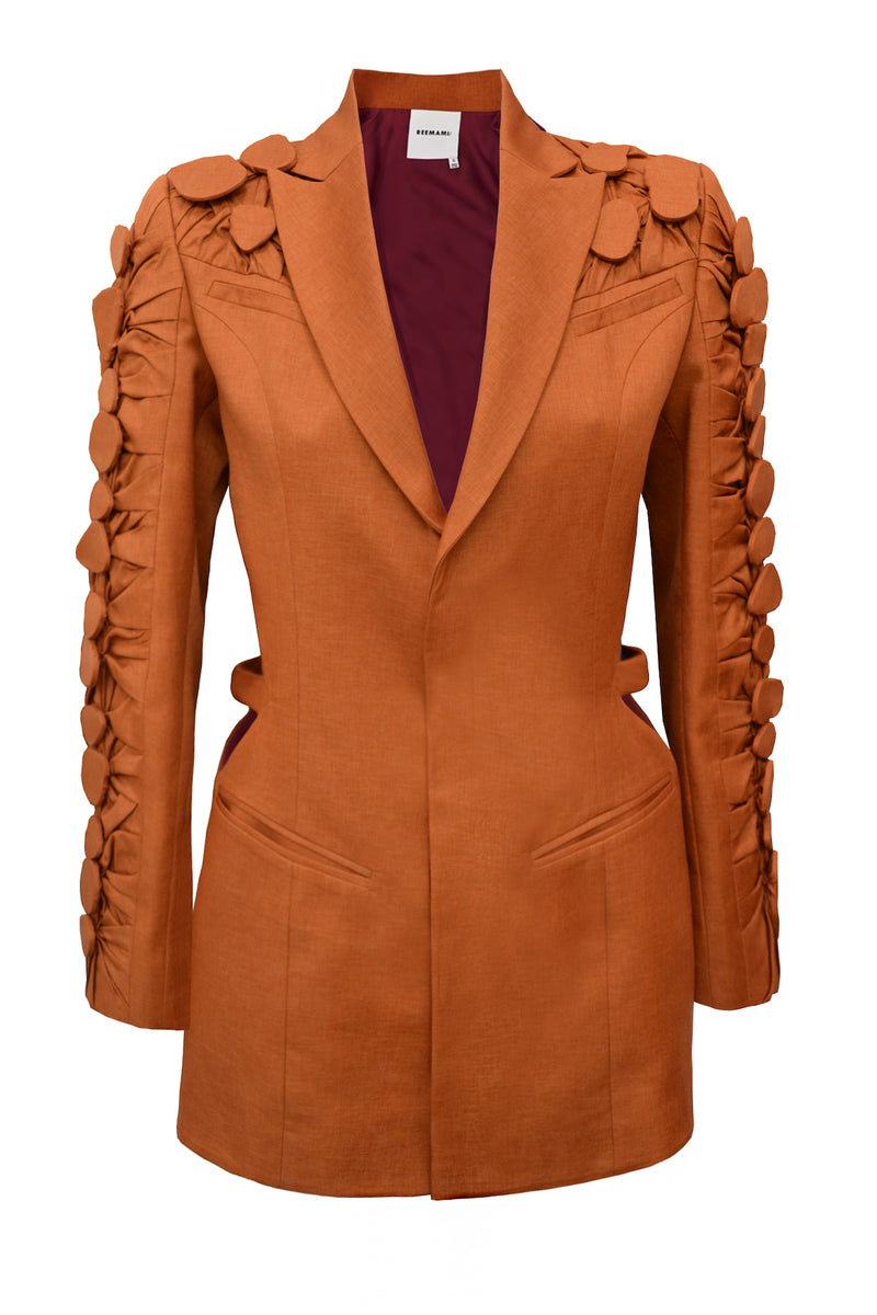 rust orange blazer with cutouts