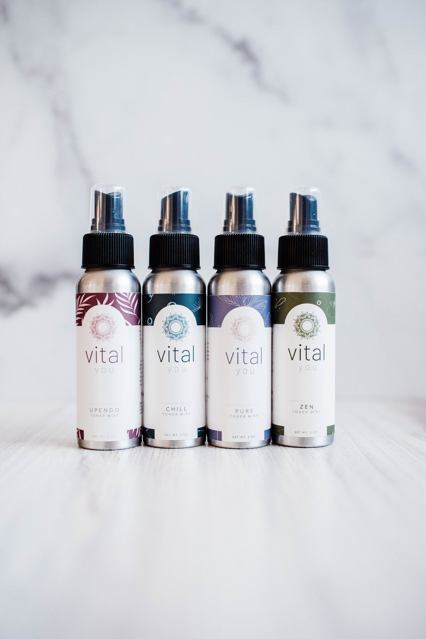 Four bottles of vital you CBD face toner mist spray with different colored labels