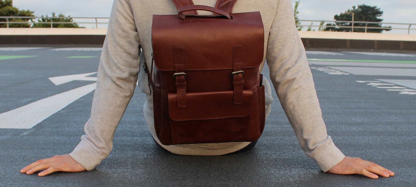 vintage street urban style photo shoot leather backpack male model