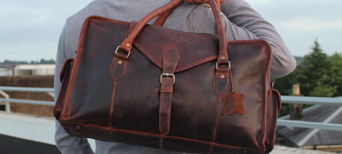male model urban photography leather holdall weekend bag vintage street style