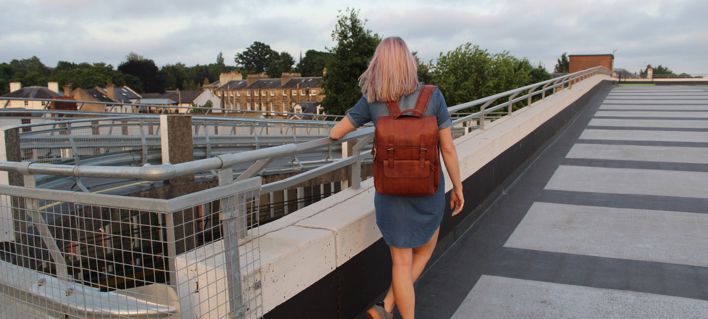 urban photography female model leather backpack street style vintage