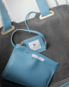 Inside of a light blue vegan leather handbag affordable luxury