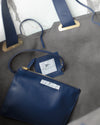 Inside of a navy blue sustainable vegan leather handbag affordable luxury