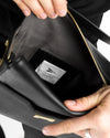 Perfect pouch in black ecofriendly crueltyfree leather