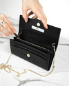 Open black mini clutch made of luxury crueltyfree leather