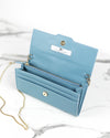 Open light blue mini clutch made of luxury crueltyfree leather