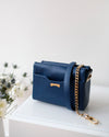 Pouch in dark blue sustainable vegan leather with gold chain strap