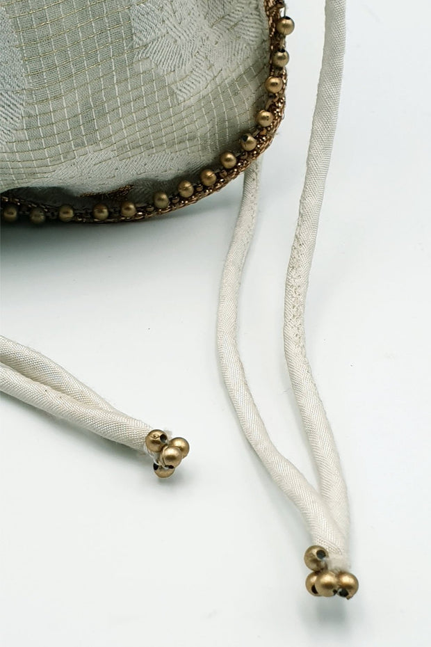 Indian Artizans - White Potli With Gold Zari And Leaf Motif