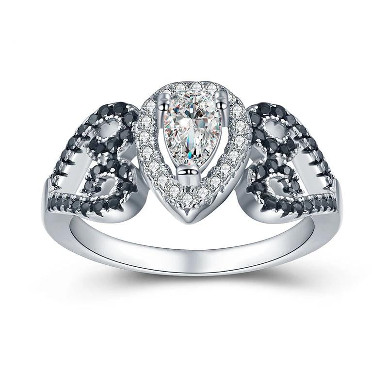 0.5 CT. Pear-Shaped Diamond Frame Engagement Ring in Sterling Silver ALLBIZIA