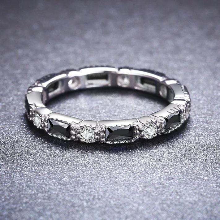 Black and White Sapphire Eternity Wedding Band in Sterling Silver