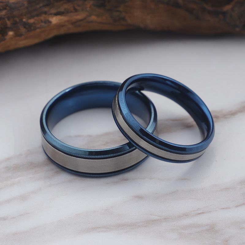 Couple's Engravable Center Ribbon Tow-Tone with Blue IP Promise Rings in Titanium
