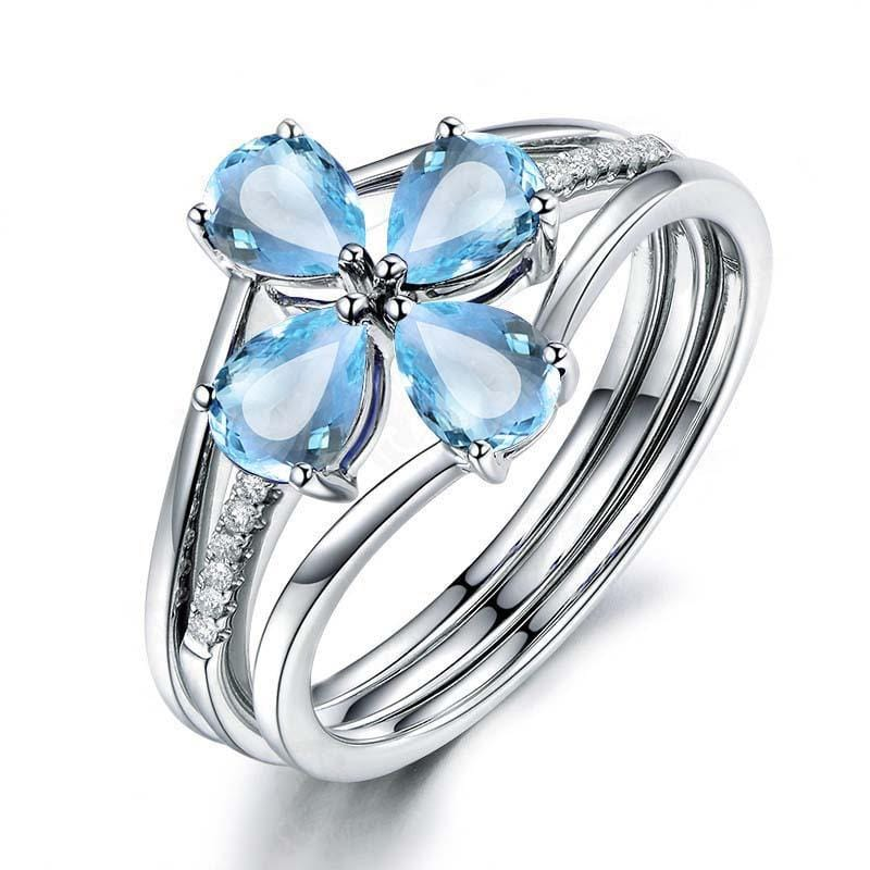 4.0 CT. Pear-Cut Blue Topaz Flower-Shaped Stackable Three Piece Ring Set Engagement Ring in Sterling Silver