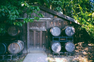urban winery photo of old oak barrel storage shed