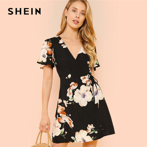 98364f7ec2 SHEIN Slit Flutter Sleeve Surplice Wrap Floral Dress Black Deep V Neck High  Waist Dresses Women
