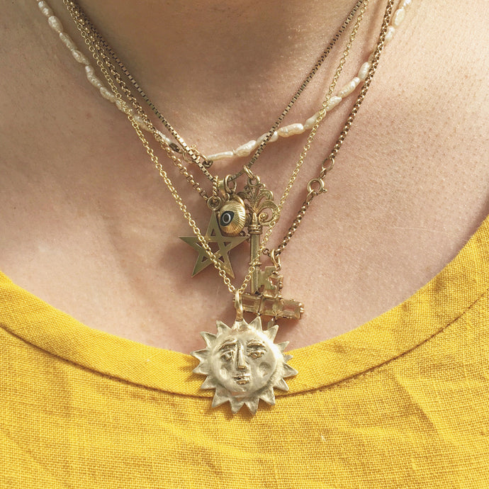 A R O R A  Sun Face Necklace