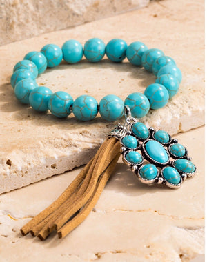 Turquoise bracelet with leather tassel