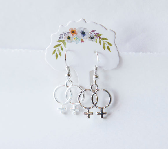Female symbol earrings