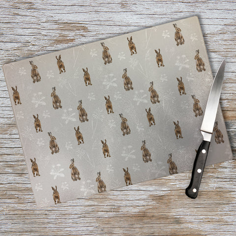 Hares in the meadow Chopping Board