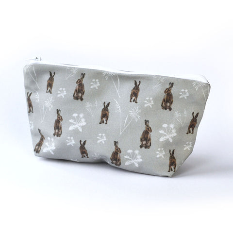 Hares in the meadow cosmetic bag