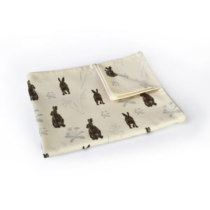 Hares in the meadow tea towel