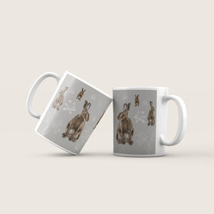 Hares in the meadow Ceramic Mug