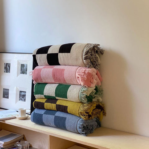 A checkered throw blanket might just be the easiest ways to elevate any living space.