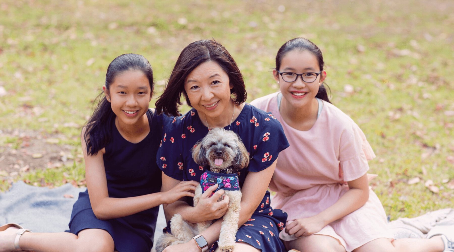 mum and two teen girls with their dog