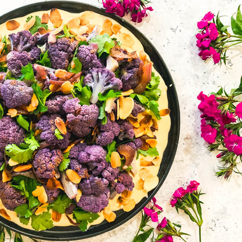 Purple cauliflower tahini salad