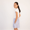 Tween girl wearing white cotton t-shirt and light blue shorts