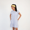Teenage girl wearing blue summer dress