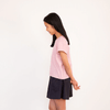 Teenage girl wearing pink cotton t-shirt and a navy skirt