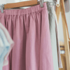 Pink and green skirt on coat hangers