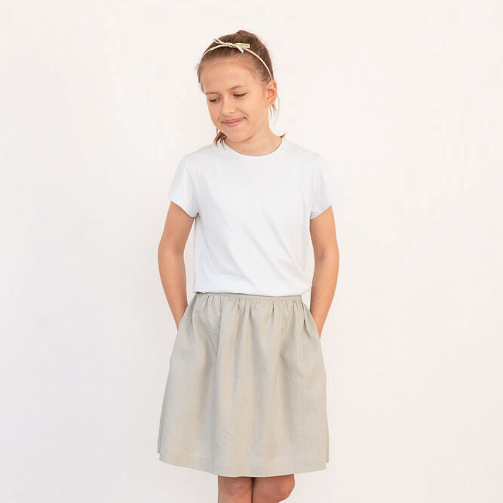 Teenage girl wearing cotton t-shirt and sage green skirt