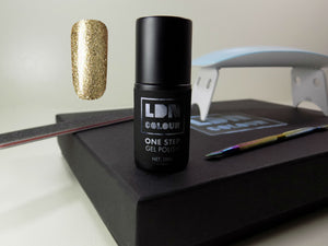 The best gel nail polish here in Monument Gold that allows you to do your gel nails at home.