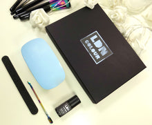 Gel nail kit created by LDN Colour. It contains a gel nail polish that sets in one step, a LED gel nail dryer, a cuticle pusher and a nail file.