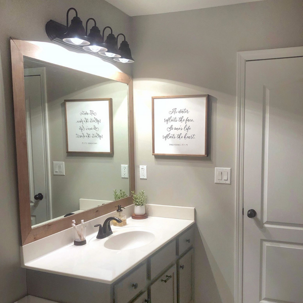 DIY Bathroom Mirror Frame - Update your builder grade mirror in a few simple steps